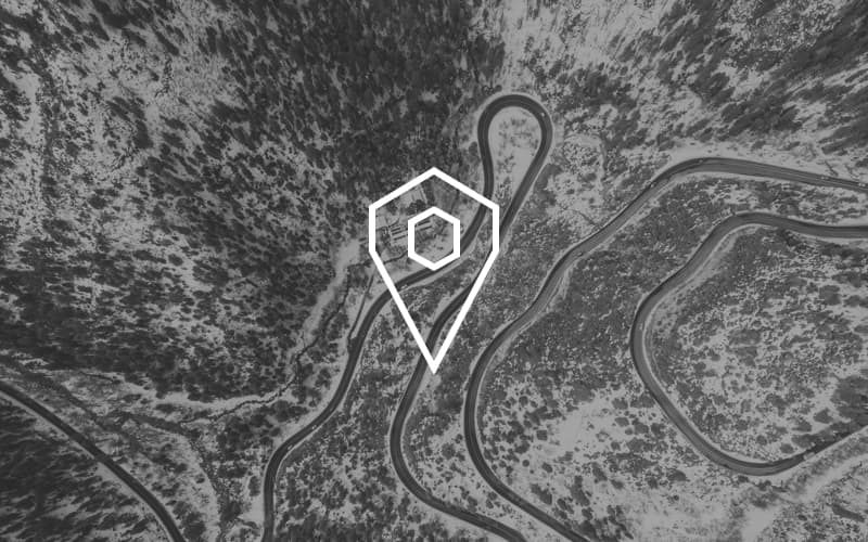 Highway trail from above with an Icon on it symbolizing Geospatial Tracking