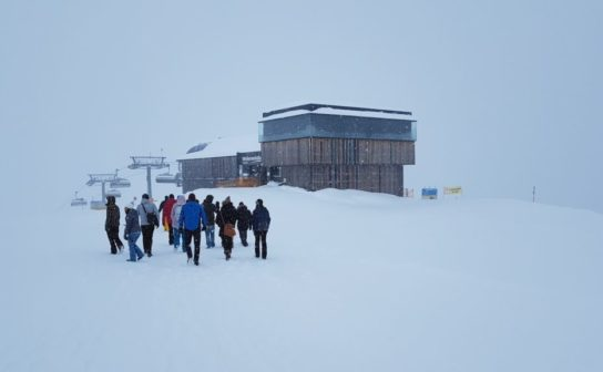 The Crate.io team walking through the snow