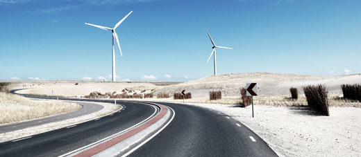 Wind turbines next to a road