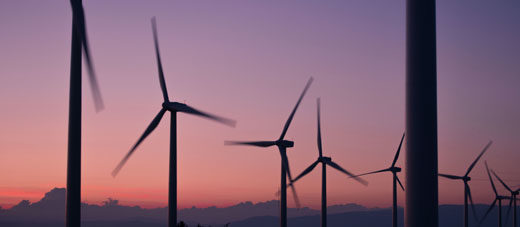 Silhouette of wind turbines during sunset © Unsplash/ Anna Jiménez Calaf