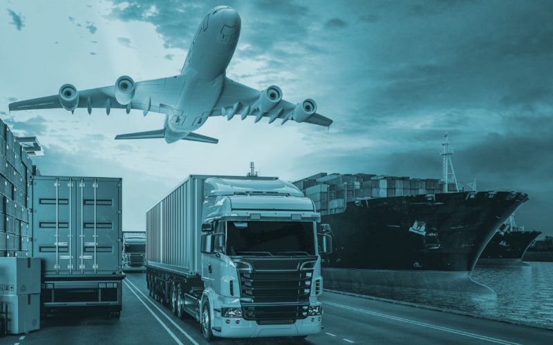 A plane, a cargo ship and a truck next to each other